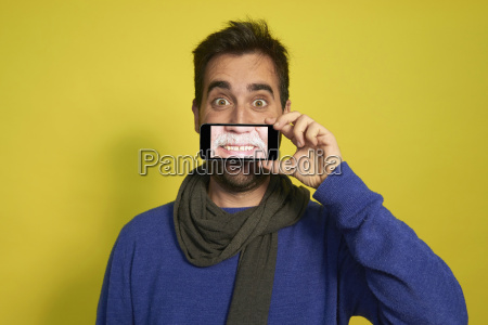portrait of man holding smartphone with