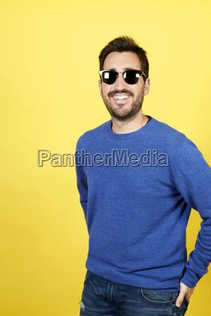 portrait of smiling man wearing sunglasses