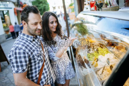 couple choosing ice cream in an