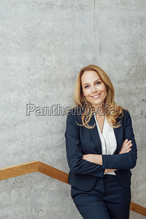 portrait of smiling businesswoman in staircase