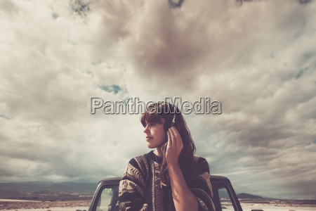young woman on the road listening