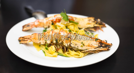 spiny lobster on fresh pasta on