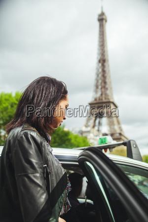 france paris young woman entering a
