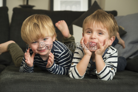 two little boys playing at home