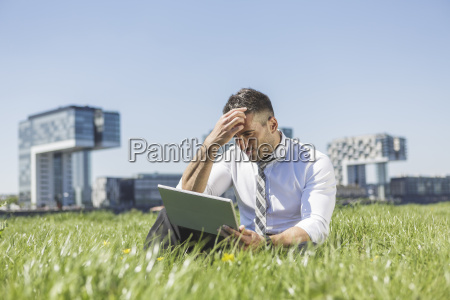 germany cologne businessman using digital tablet