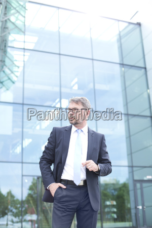 businessman outside office building
