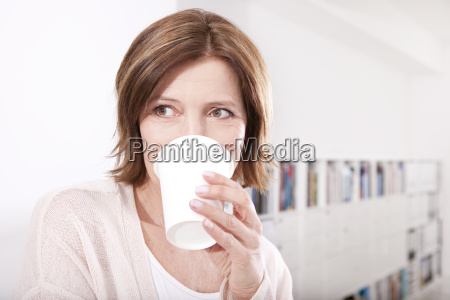 portrait of woman drinking coffee to