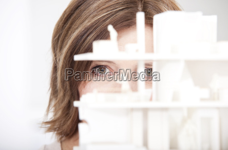 woman watching architectural model close up
