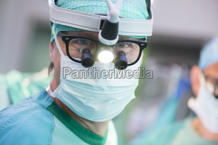 portrait of heart surgeon with headlamp