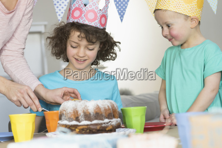 girls birthday party with cake