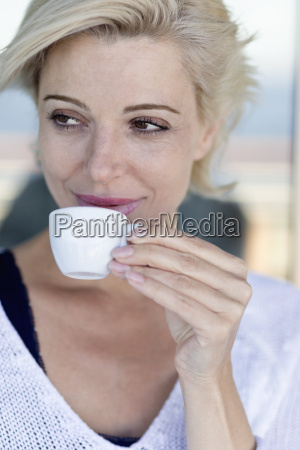 mature woman with a cup of