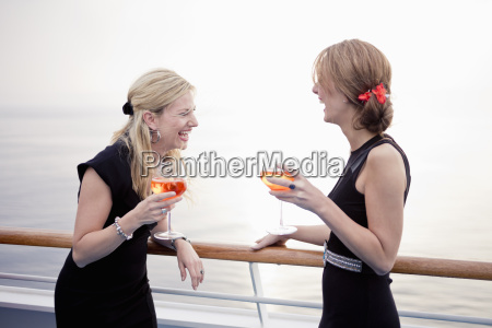 two laughing women with aperitive