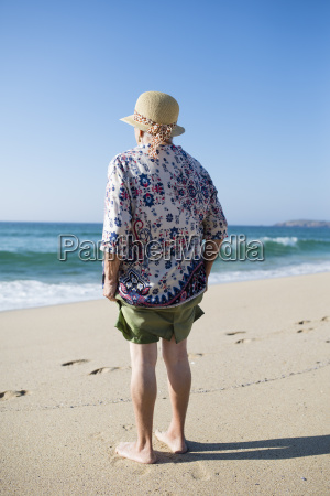 back view of senior woman standing