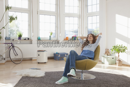 relaxed woman at home sitting in