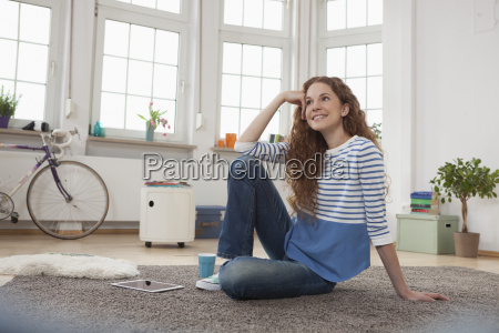smiling woman at home sitting on