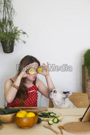 french bulldog watching woman covering her