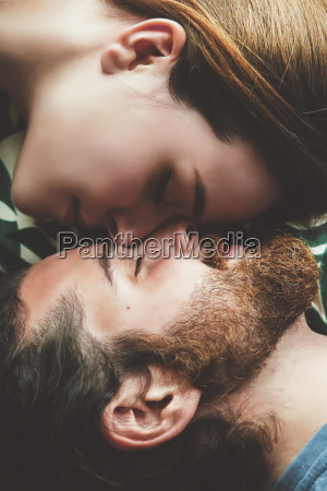 young couple in love relaxing head