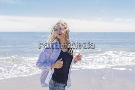 portrait of smiling young woman running