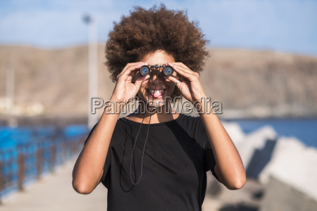smiling young woman with binocular