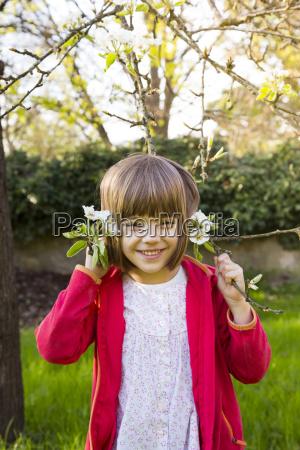 portrait of smiling little girl holding