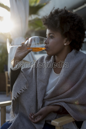 young woman sitting in bar drinking