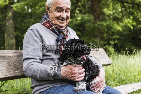 smiling senior man sitting with his
