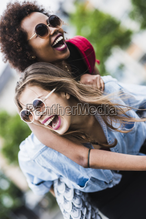 laughing woman giving her friend a