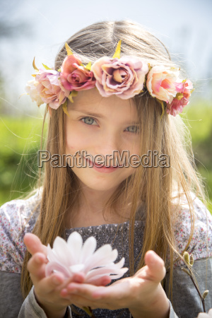 portrait of smiling girl with wreath