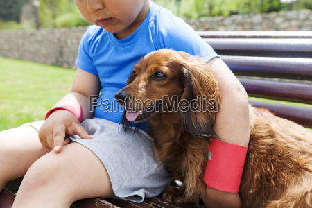 little boy with dog sitting on