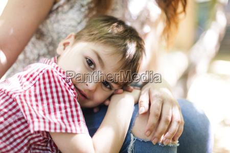 portrait of little boy near to