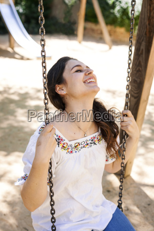 laughing young woman sitting on a