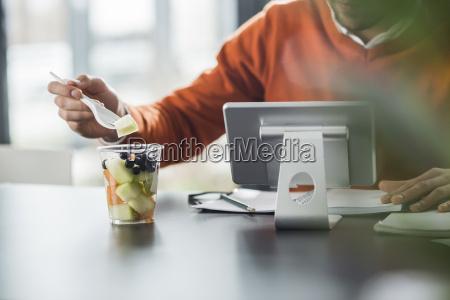 young man having a fruit salad