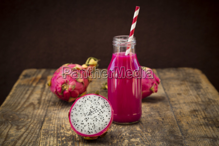 glass bottle of dragon fruit smoothie