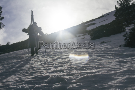 backlighting of a man with skis