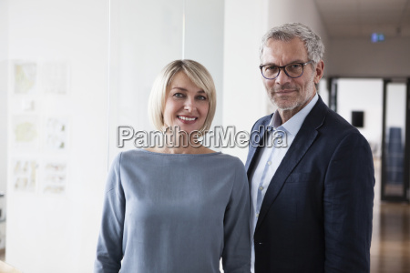 businessman and woman in office portrait