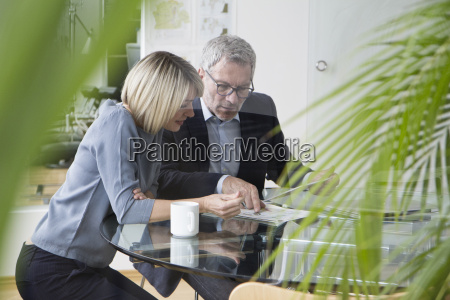 businessman and woman working together in