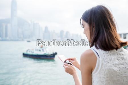 woman using cellphone at hong kong