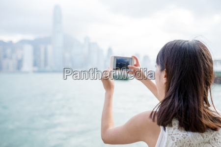 woman taking photo of the skyline