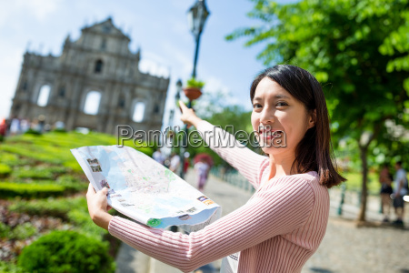 woman holding city map in macau