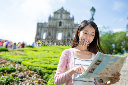 woman using city map in macau