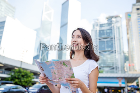 woman holding a city map in