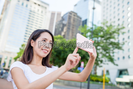 woman use of cellphone to take