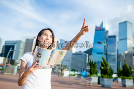 asian woman use of city map