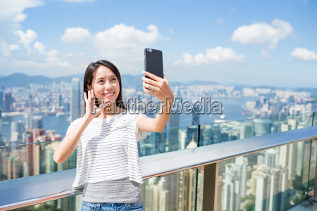 woman using mobile phone to take