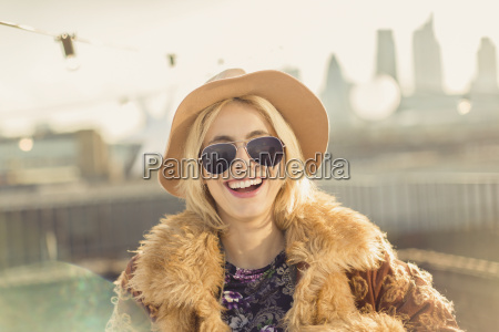 portrait enthusiastic young woman wearing hat