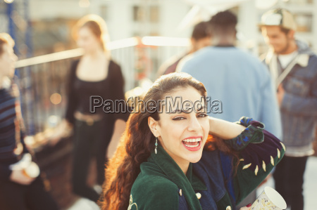 portrait enthusiastic young woman enjoying rooftop