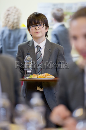 portrait confident middle school student eating