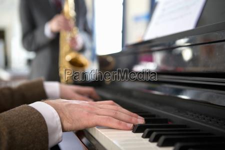 close up music teacher playing piano