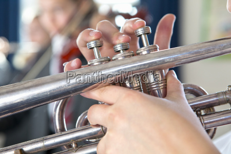 close up high school student playing