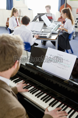 music teacher teaching high school students